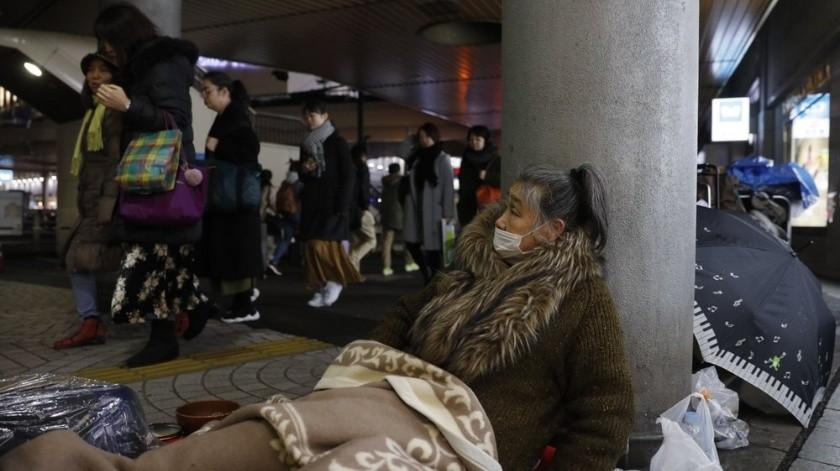 Las autoridades de Tokio niegan estar haciendo esfuerzos para retirar a los indigentes con motivo de la cita del próximo verano.(AP)